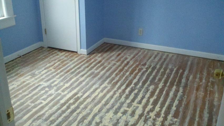 severely damaged wood flooring