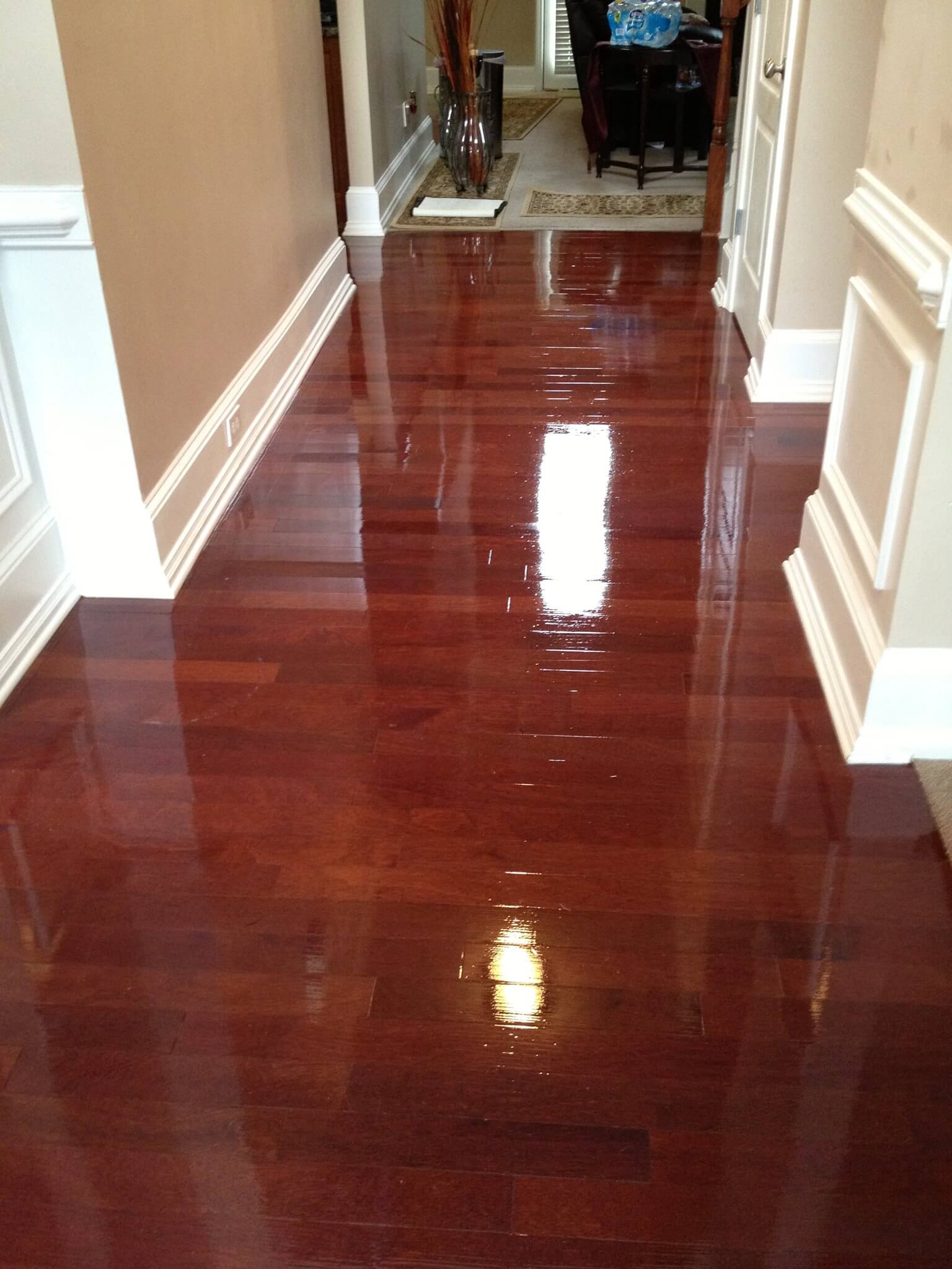 a fixed warped hardwood floor thanks to refinishing