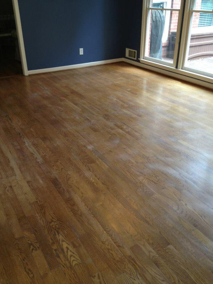 lightly scratched and dirty hardwood floor.