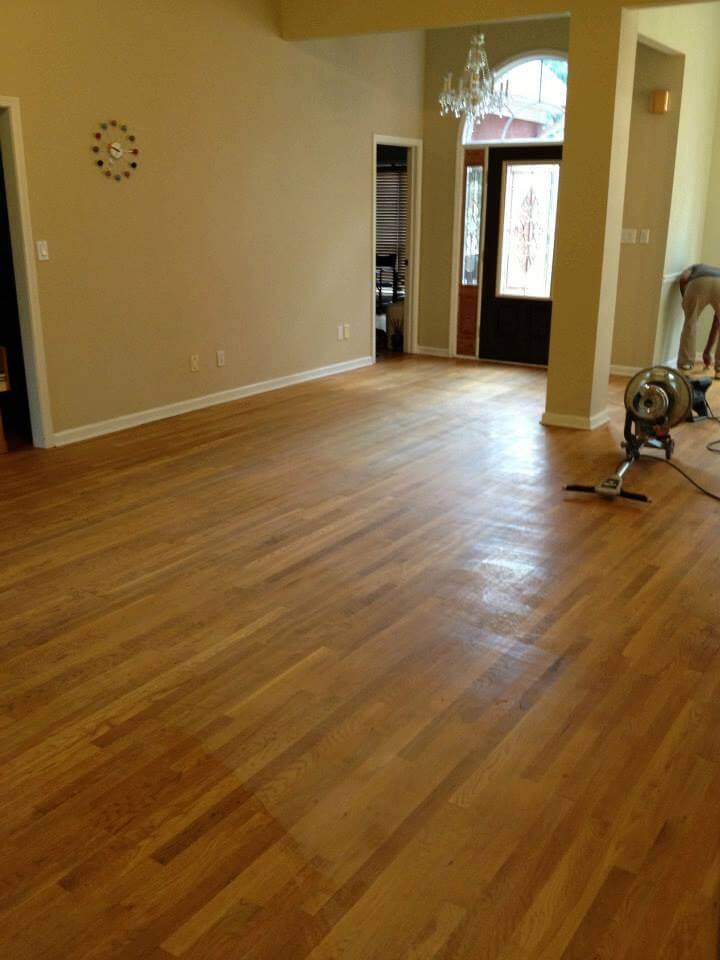 tan hardwood floor with minor scratches