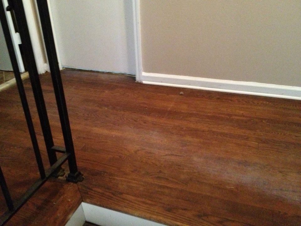 A wood floor that needs to be refinished